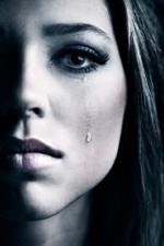 Bild der typischen Traurigkeit von einer Frau mit Depression aus München