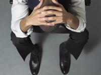 Typischer Manager aus München in einer Burnout Phase ab der Stufe 7